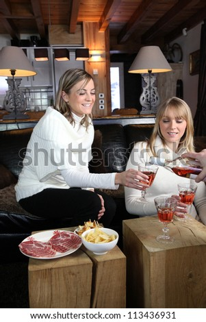 Friends having a drink - stock photo