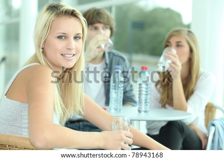 Friends having a drink of water - stock photo