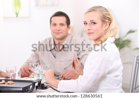 Friends having a nice dinner party - stock photo