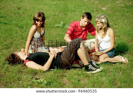 friends having a picnic outdoors - stock photo