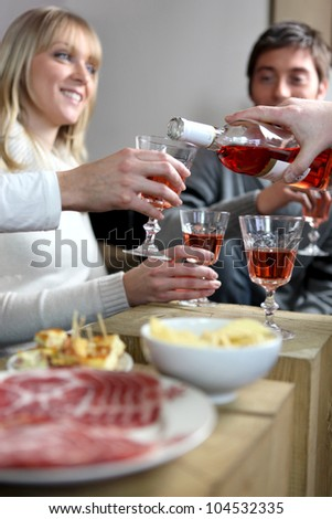 Friends having an informal dinner party - stock photo