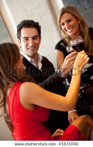 Friends having dinner and toasting at a restaurant - stock photo