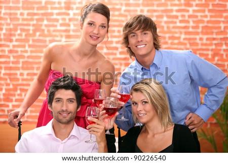 Friends having dinner in a restaurant - stock photo
