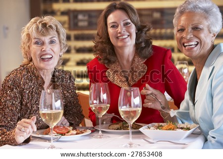 Friends Having Dinner Together At A Restaurant - stock photo