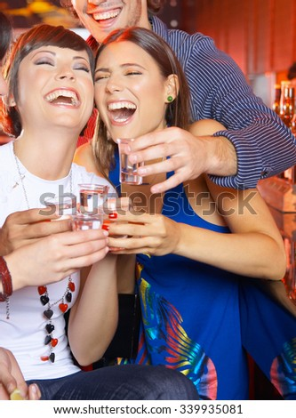 Friends having drinks at the bar  - stock photo