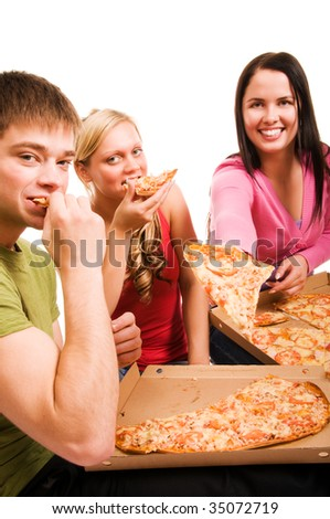 Friends having fun and eating pizza - stock photo
