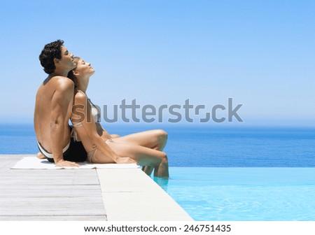 Friends Having Fun In Swimming Pool - stock photo