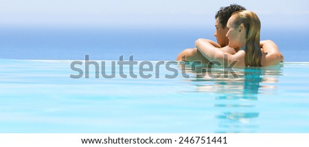 Friends Having Fun In Swimming Pool - stock photo