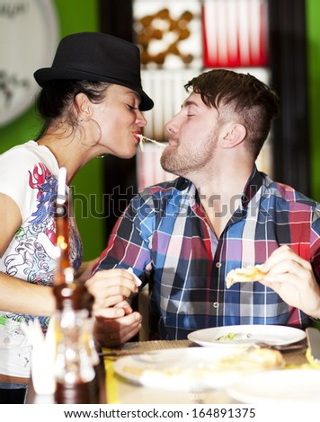 Friends having fun while eating pizza  - stock photo