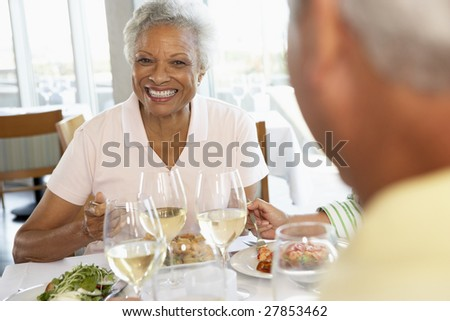 Friends Having Lunch Together At A Restaurant - stock photo