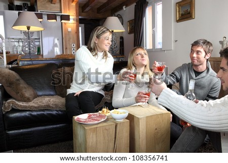 Friends having party at home - stock photo