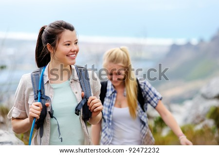 friends hiking together outdoors exploring the wilderness and having fun