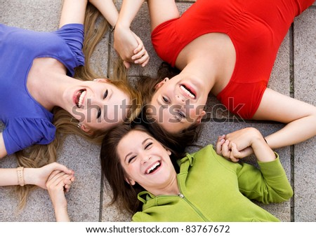 Friends holding hands - stock photo