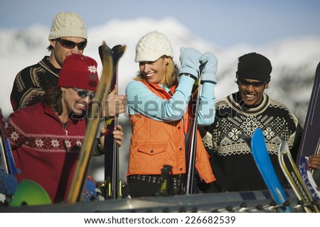 Friends Holding Skis - stock photo