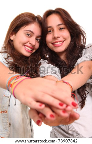 Friends holding their hands in signal of friendship and fellowship - stock photo