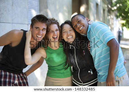 friends hugging and laughing - stock photo