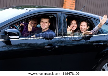 Friends in a black car going in vocation