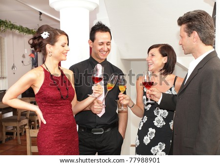 friends in a restaurant - cheers clink glasses -food - stock photo