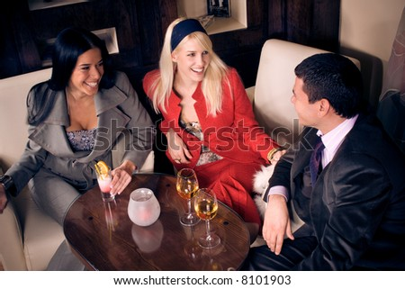 friends in cafe, sitting with drinks - stock photo