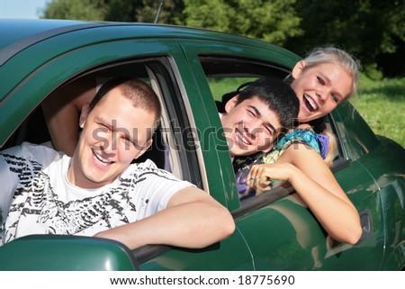 Friends in car - stock photo