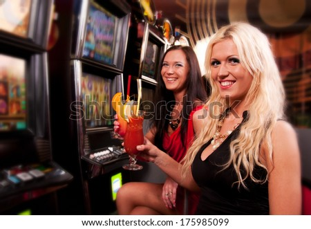 Friends in Casino on a slot machine - stock photo