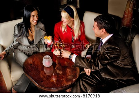 friends in pub with drinks - stock photo