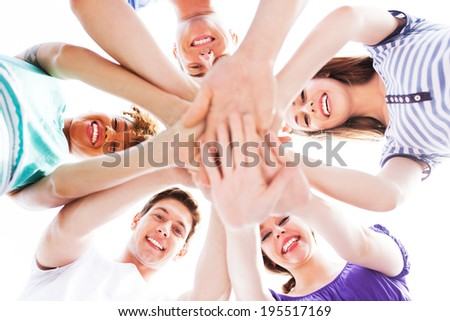 Friends joining hands - stock photo