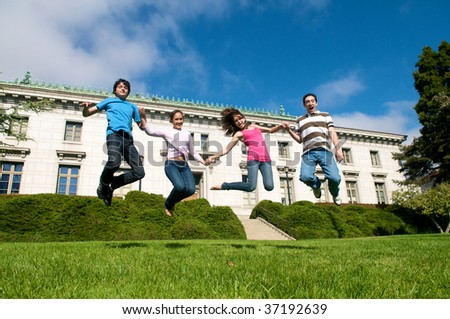 Friends Jumping - stock photo