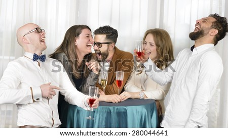 Friends laughing hilarious in a bar, holding glasses of wine
