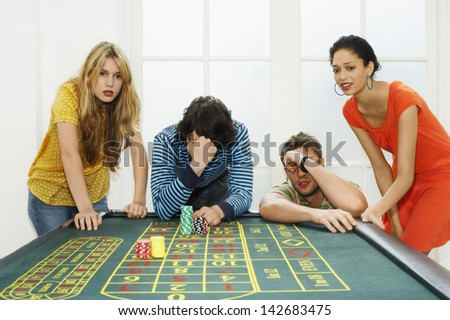 Friends Losing On Roulette Table - stock photo