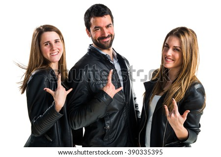 Friends making horn gesture - stock photo