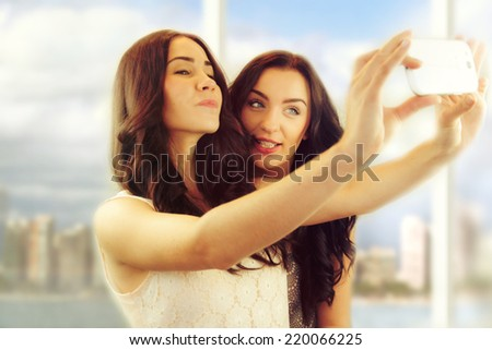 """Friends making selfie. Two beautiful young women making """"selfie""""  - stock photo"""