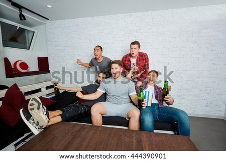 Friends male watching sports, football. Fans drink beer, eating popcorn, pizza, fun, scream, laugh. The concept of men's rest. - stock photo