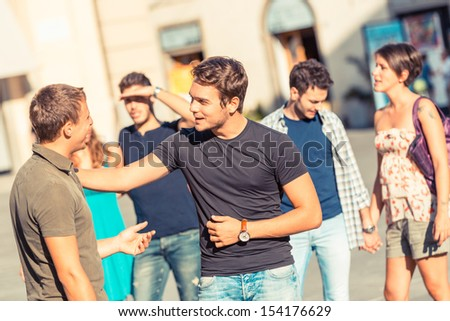 Friends Meeting in City Square - stock photo
