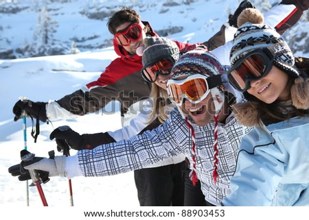 Friends on the ski slopes - stock photo