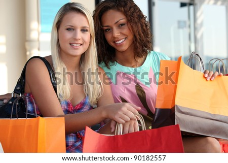 Friends out shopping together - stock photo
