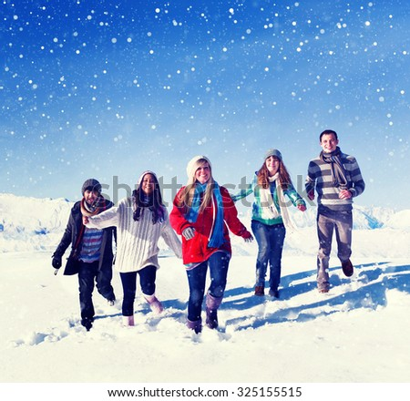 Friends Outdoors During Winter Snow Travel Vacation Concept - stock photo