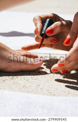 Friends painting her nails - stock photo