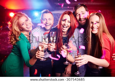 Friends partying at nightclub