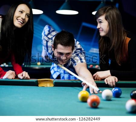 Friends playing billiard - stock photo