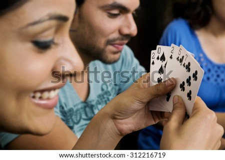 Friends playing cards - stock photo