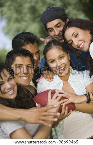 Friends Playing Football - stock photo