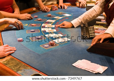 friends playing in casino black jack table - stock photo