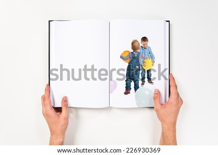 Friends playing with balloons printed on book