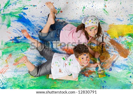 Friends playing with painting on the background painted - stock photo