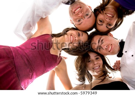friends portrait having fun all elegantly dressed ready to party over a white background - stock photo
