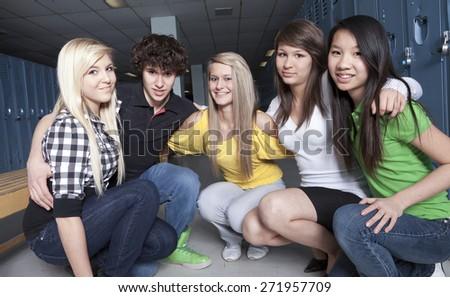 Friends posing in a cloakroom. Nice portrait. - stock photo