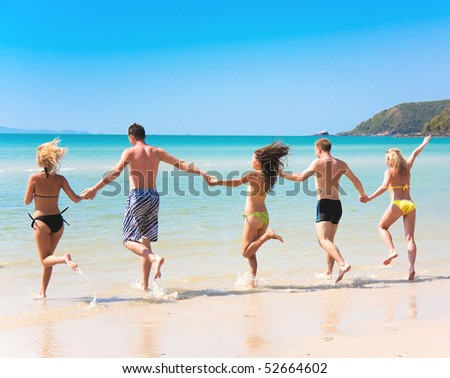 friends run to the sea - stock photo