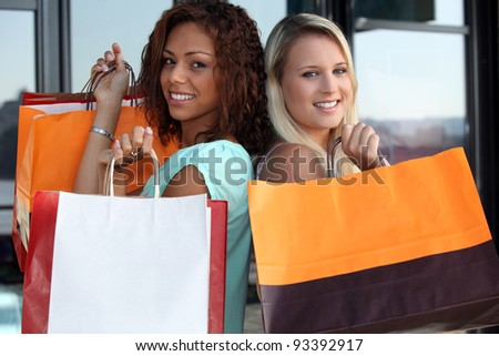 Friends shopping together - stock photo