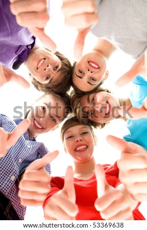 Friends showing thumbs up sign - stock photo